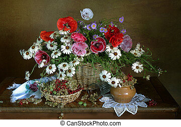 Still life with flowers and berries on the table.