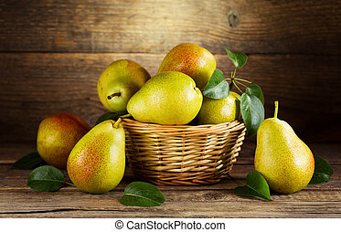 still life with fresh pears on wooden background