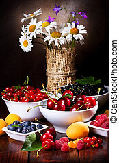 still life with fruits and berries