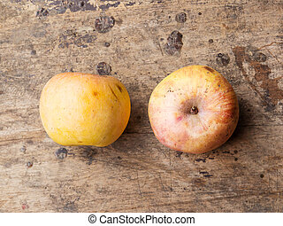 Still life with old apple on wooden background