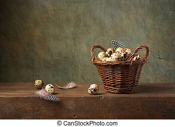 Still life with quail eggs in a basket