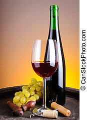 Still life with red wine and grapes