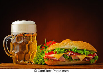 Still life with sandwich and beer