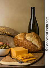 Still life with sausage cheese and bread - A still life with...