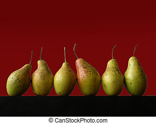 still life with six pears on red background