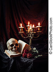 Still life with skull, book and candlestick - Human skull on...