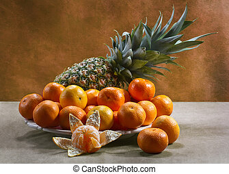 Still life with tangerines and pineapple