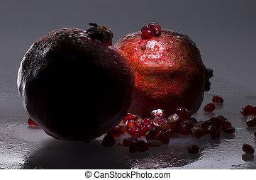 Still-life with two pomegranates