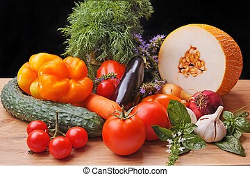 Still life with vegetables and fruits on black