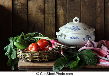 Still life with vegetables on the table. Fresh vegetables in basket.