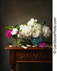 Still life with white peonies in a blue jug