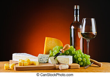 white wine, cheese and grapes - still life with white wine, ...