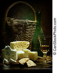 Still-life with wine and cheese of different grades