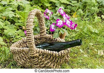 still life with wine bottle in a garden
