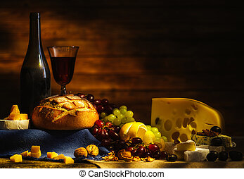 Still life with wine, grapes, bread and various sorts of cheese.