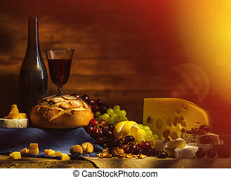 Still life with wine, grapes, bread and various sorts of...