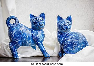 Still life wooden carving cats