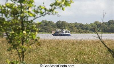 Still shot of a boat travelling down a river - Still...