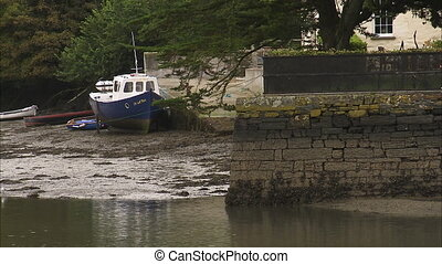 Still shot of a water canal at low tide