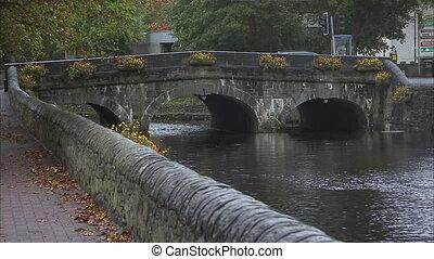Still shot of an old Irish stone bridge over a canal.