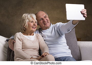 Still young at heart - Shot of an elderly couple taking a...