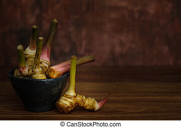 stilllife - Still life with galangal in a pottery cup on ...