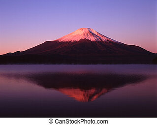 Stillness - Reflections of Mount Fuji in a still early...