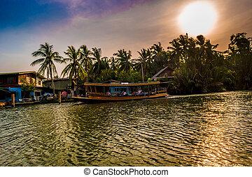 Stilt houses above river in rural Thailand.