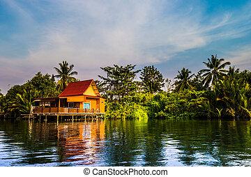 Stilt houses above river in rural Thailand. - Stilt houses ...