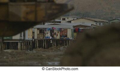 Stilt houses on a muddy ground, Hanuabada village