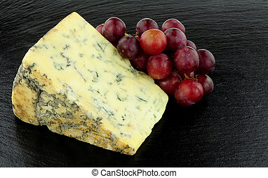 Stilton Cheese And Red Grapes - Blue veined strong English...