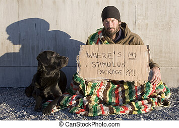 Stimulus - A man sits with a cardboard sign asking where his...