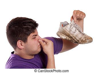 stinkende, athletischer schuh