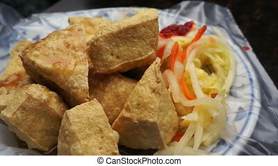 Stinky tofu famous taiwan food - Fried stinky tofu serve on...