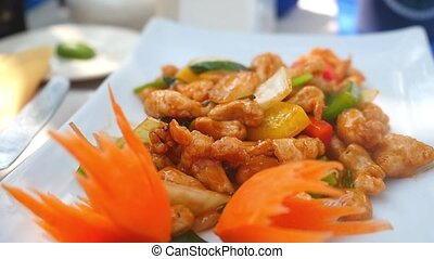 Stir fried chicken, vegetables with cashews. Asian food,...