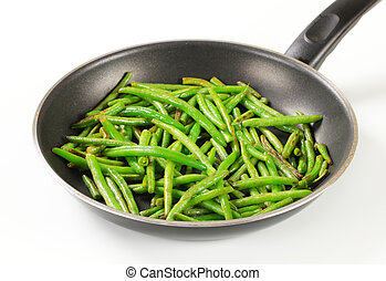 Stir-fried green beans - Green beans on a frying pan