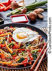 Stir fried korean Japchae, vertical, close up