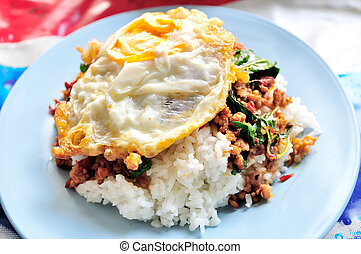 stir fried minced pork and chili ,basil served with steamed rice