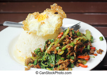 stir fried minced pork and chili ,basil served with steamed rice and fried egg