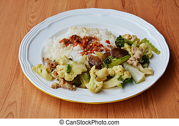 stir fried mixed vegetable with pork and spicy shrimp paste on rice