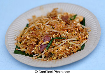 Stir fried noodles or Char Koay Teow served on plate -...