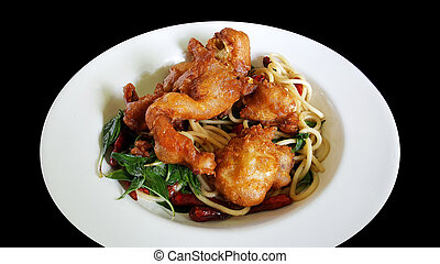 stir fried spaghetti with dried chili and soft shell crab, clipping part isolated on black background