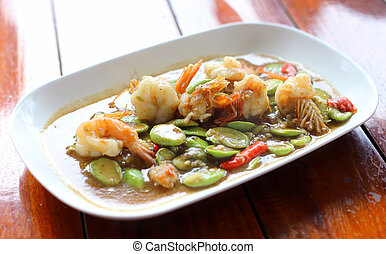 Stir-fried stink bean with shrimp on wood table
