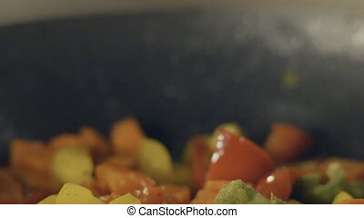 Stir fried vegetables in the pan, slow motion