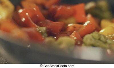 Stir fried vegetables in the pan, slow motion - Stir fried...