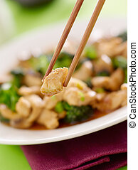 stir fry chopstick closeup eating chicken and broccoli