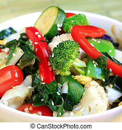 Stir fry vegetables topped with sesame seeds.