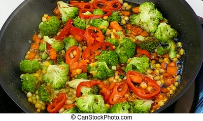 stir in a skillet fry vegetables - In a frying pan, a...