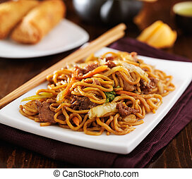 stirfried chinese beef lo mein with chopsticks