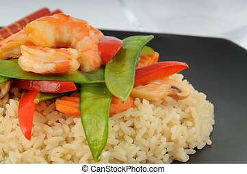 Stirfry of shrimp and vegetables on white rice.